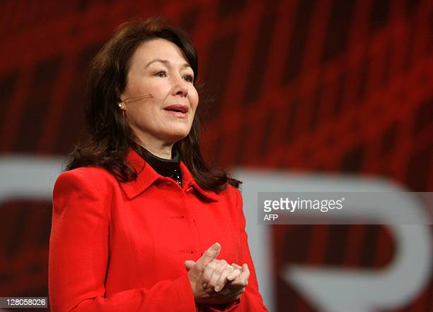 Oracle President Safra Catz introduces Cisco Systems CEO John Chambers to attendees of a keynote at the Moscone Center in San Francisco during the...