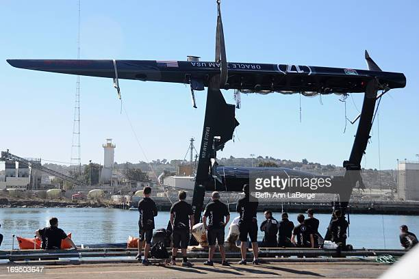 CONTENT] Oracle team members watch as a 72foot Oracle Racing catamaran is hoisted onto Pier 80 on Wednesday Oct 17 2012 in San Francisco Calif The...