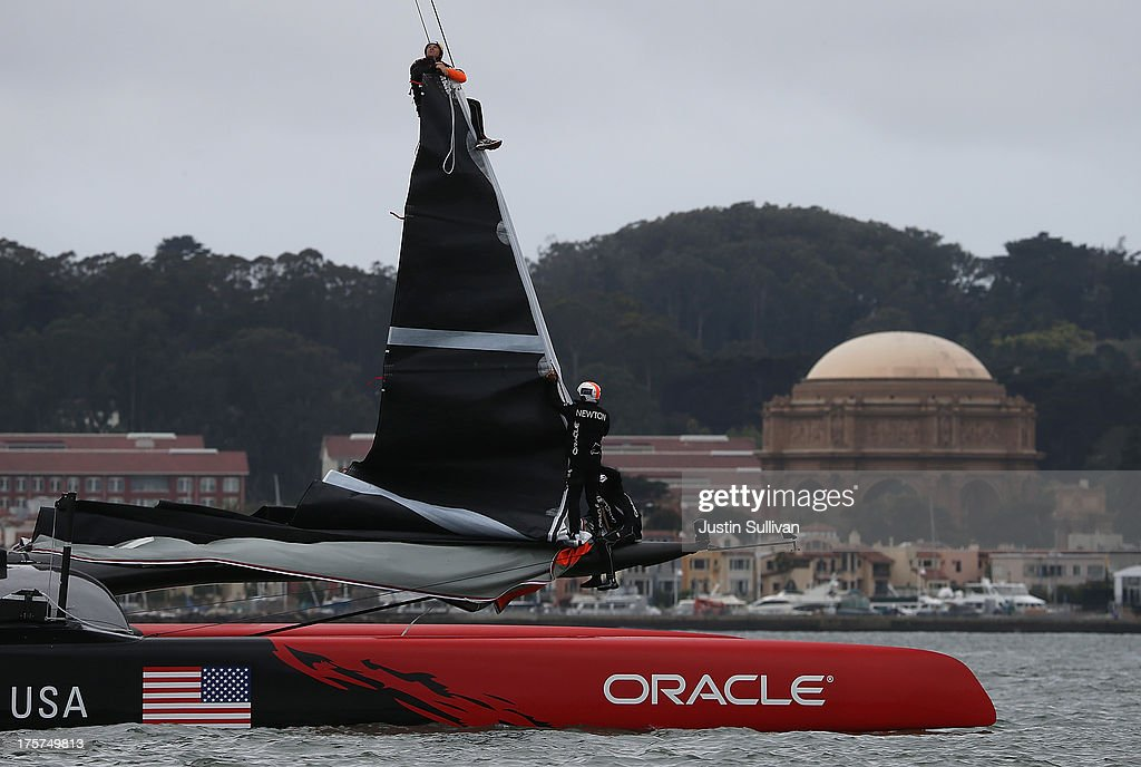 Oracle Team USA crew members set up their jib as they practice before the start of race two of the Louis Vuitton Cup semi final on August 7, 2013 in San Francisco, California. The winner of the Louis Vuitton Cup goes on to race against Oracle Team USA in the America's Cup Finals that start on September 7.