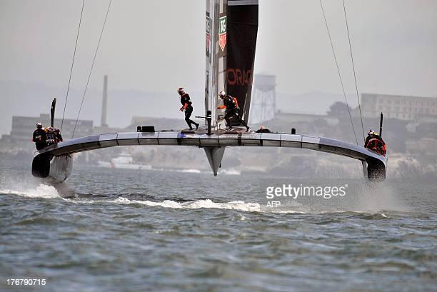 Oracle Team USA sails near Alcatraz during a practice run in San Francisco California on August 18 2013 AFP PHOTO/Josh Edelson