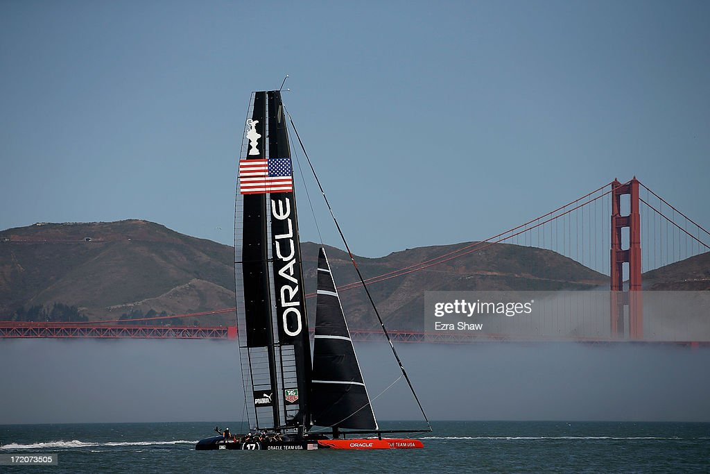 Oracle Team USA sails near the Golden Gate Bridge during a training session on July 1, 2013 in San Francisco, California. Opening ceremony for the America's Cup is July 4, 2013. The finals begin on September 7, 2013 in San Francisco.