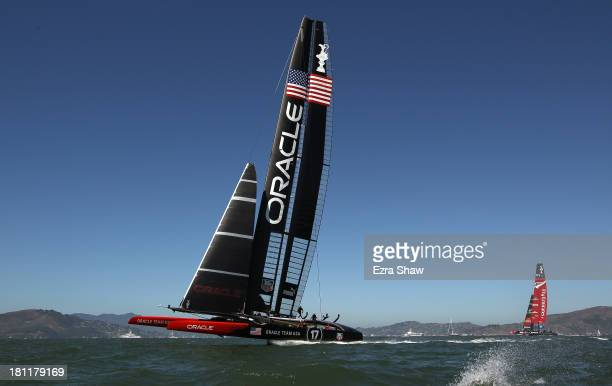 Oracle Team USA skippered by James Spithill leads Emirates Team New Zealand skippered by Dean Barker in race 12 of the America's Cup Finals on...