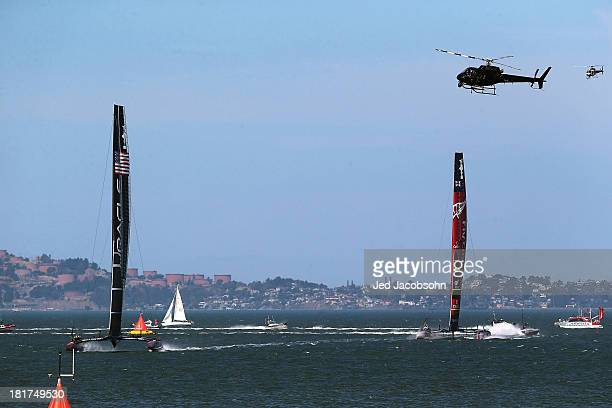 Oracle Team USA skippered by James Spithill sails ahead of Emirates Team New Zealand skippered by Dean Barker during race 17 of the America's Cup...