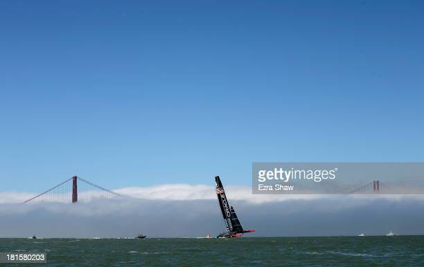 Oracle Team USA skippered by James Spithill warms up near the Golden Gate Bridge before racing against Emirates Team New Zealand in race 14 of the...