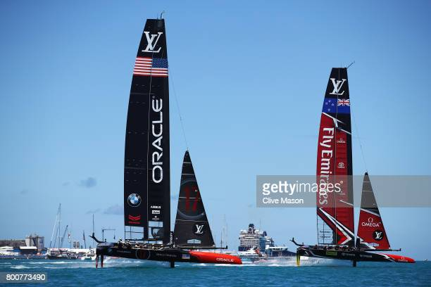 Oracle Team USA skippered by Jimmy Spithill competes with Emirates Team New Zealand helmed by Peter Burling on day 4 of the America's Cup Match...