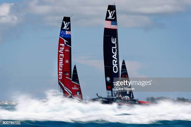 Oracle Team USA skippered by Jimmy Spithill in action racing against Emirates Team New Zealand helmed by Peter Burling on day 4 of the America's Cup...
