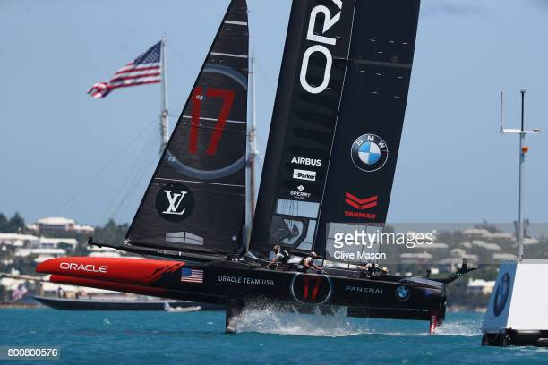 Oracle Team USA skippered by Jimmy Spithill round a mark on day 4 of the America's Cup Match Presented by Louis Vuitton on June 25, 2017 in Hamilton,...