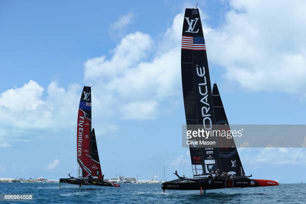 Oracle Team USA with helmsman Jimmy Spithill competes with Emirates Team New Zealand with helmsman Peter Burling during day 1 of the America's Cup...