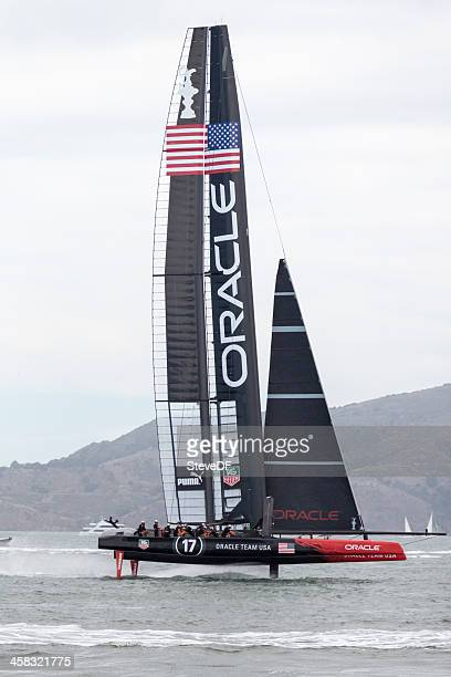oracle team usa's america's cup catamaran flying downwind - catamaran race stock photos and pictures
