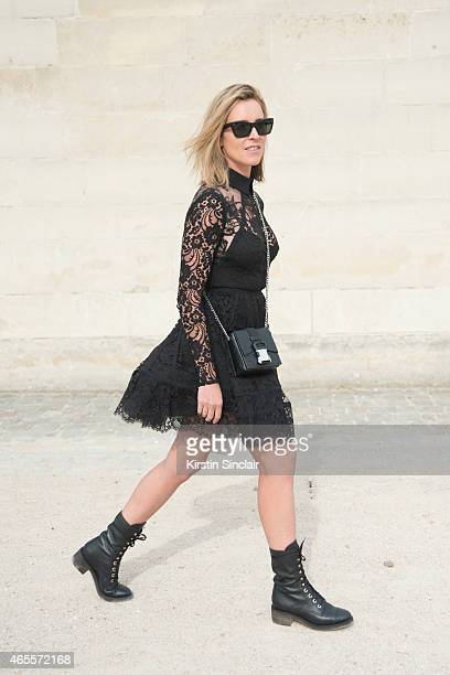 Oraclefoxcom writer Amanda Shadforth wears an Elie Saab dress Chanel boots Christopher Kane bag and Celine sunglasses on day 5 of Paris Collections...