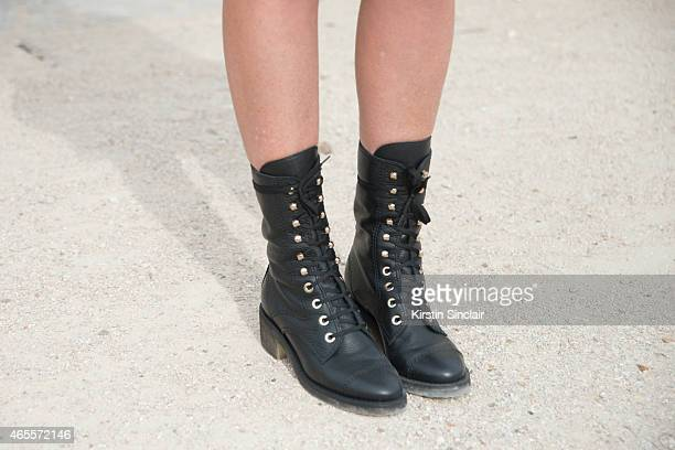 Oraclefoxcom writer Amanda Shadforth wears Chanel boots on day 5 of Paris Collections Women on March 07 2015 in Paris France
