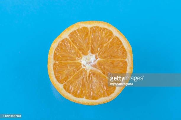 orage slice. - fruta stock photos and pictures