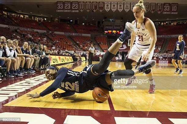 Oral Roberts University Jordan Gilbert dives for the ball against University of Oklahoma player Gabbi Ortiz during the Oral Roberts University vs...