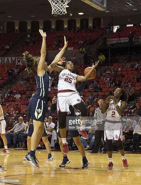 Oral Roberts University player Montserrat Brotons blocks University of Oklahoma player Goya Carter during the Oral Roberts University vs University...