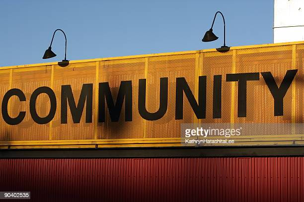 orange and black community sign on a building - community centre stock pictures, royalty-free photos & images