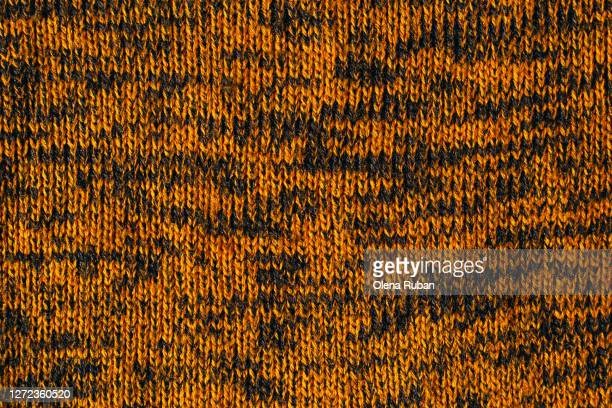 orange and black knitted texture close up as background - pattern stock pictures, royalty-free photos & images