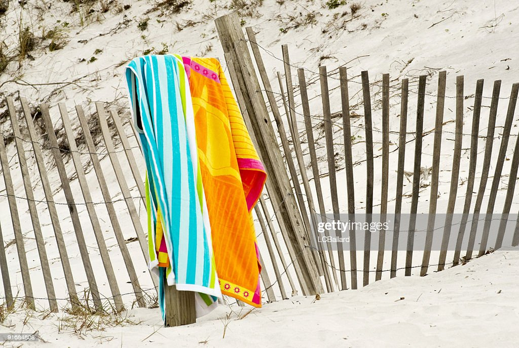 hanging beach towel. Orange And Blue Beach Towel Hanging Over A Weathered Fence S