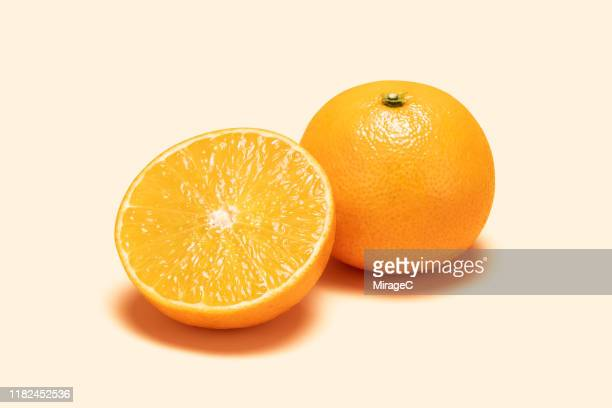 orange and cross section on colored background - orange colour stock pictures, royalty-free photos & images
