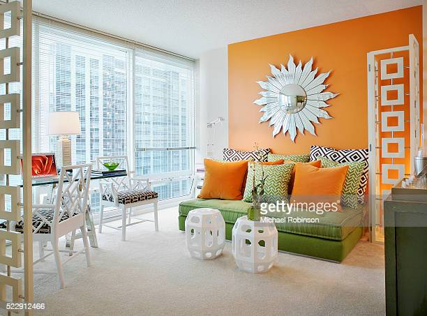 Orange and Green Accents in Living Room