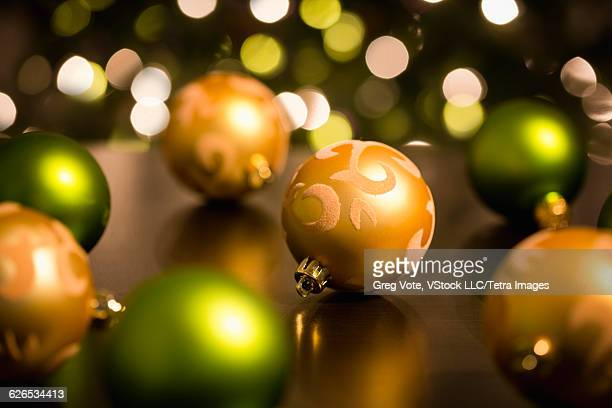 Orange and green christmas baubles
