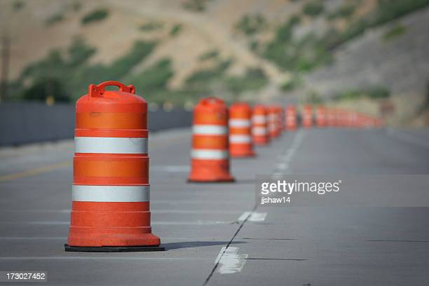 Orange and white construction cones closing a road Lane