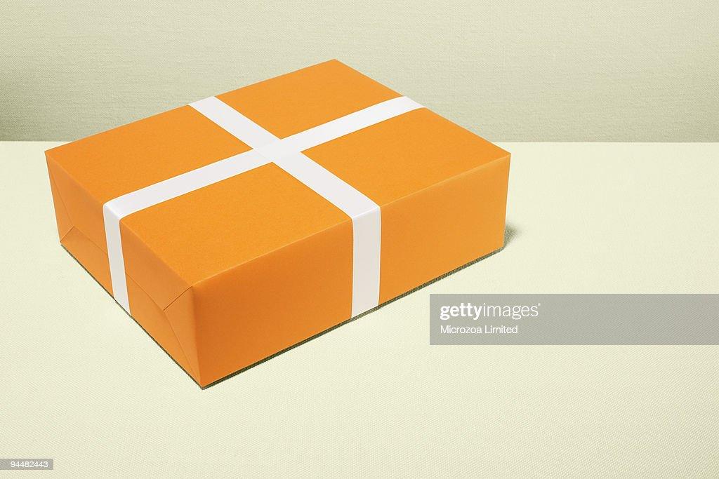 Orange and white gift : Stock Photo