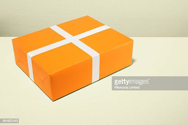 orange and white gift - microzoa stock pictures, royalty-free photos & images