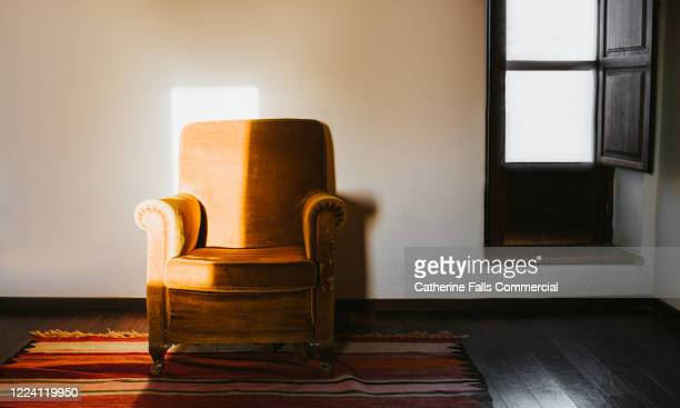 orange armchair - chair stock pictures, royalty-free photos & images