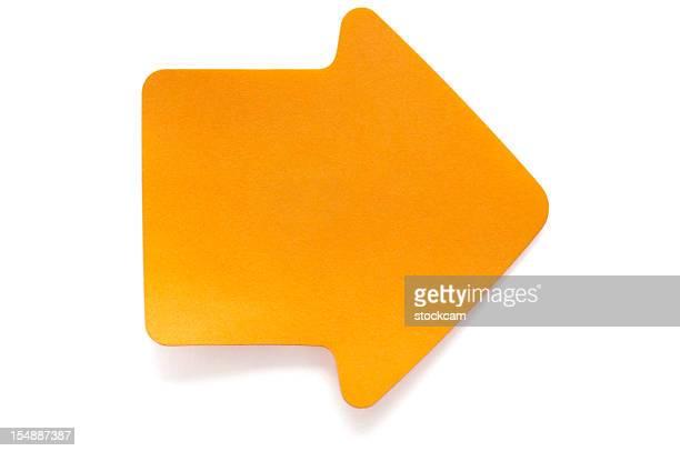 Orange arrow post-it note on white