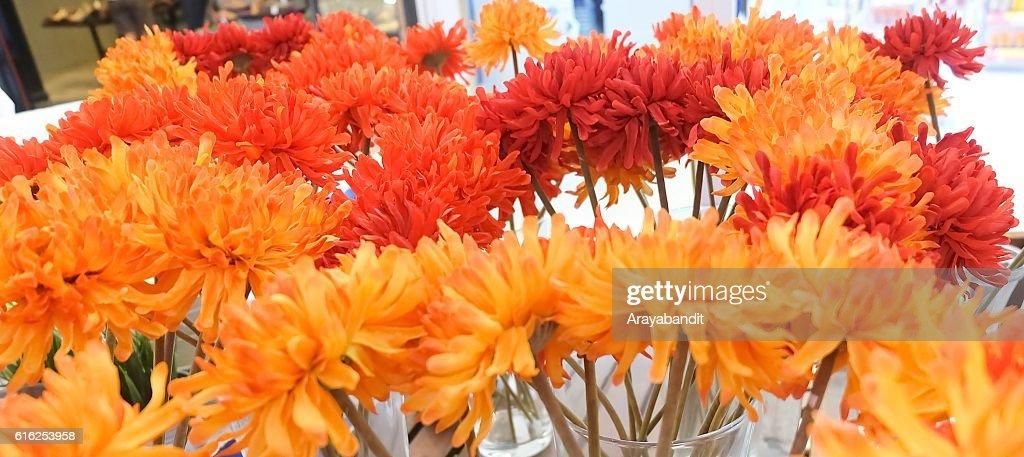 Orange Artificial Gerbera Flowers in Glass Vase : Foto de stock