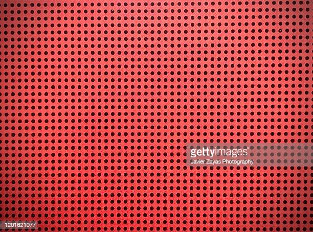 orange background with black circles - mesh textile stock pictures, royalty-free photos & images