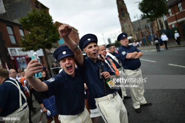 Orange band men cheer as they wait for the start of the annual 12th of July Orange march and demonstration takes place on July 12 2018 in Belfast...