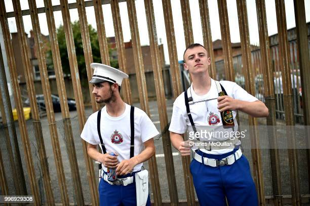 Orange band men wait for the start of the annual 12th of July Orange march and demonstration takes place on July 12 2018 in Belfast Northern Ireland...