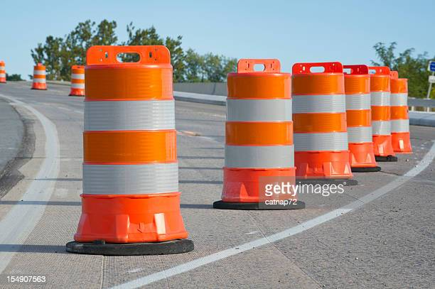 Orange barrels used in highway maintenance construction