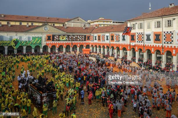 Orange battle teams' members participate in the traditional Battle of the Oranges on February 11 2018 in Ivrea Italy The Battle of the Oranges the...