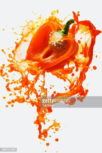 Orange bell pepper & Vegetables juice in the air