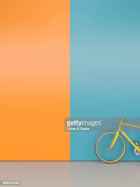orange bike at colourful wall