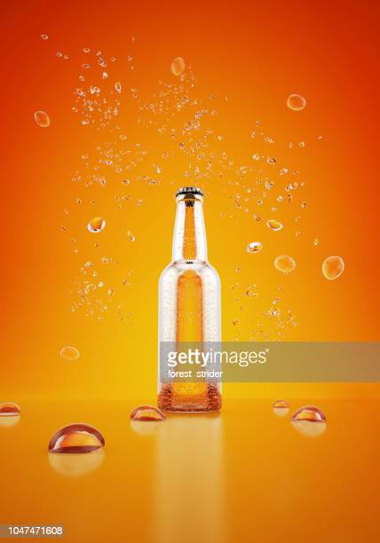 orange bottle with water drops on yellow background - tonic water stock pictures, royalty-free photos & images
