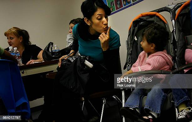 Orange Ca – Delia Garcia of Tustin tries to quiet her daughter Nicole while she attempts to fill out paperwork to apply for food stamps After a...