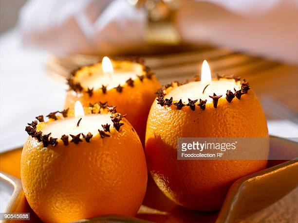 Orange candles with cloves, close up