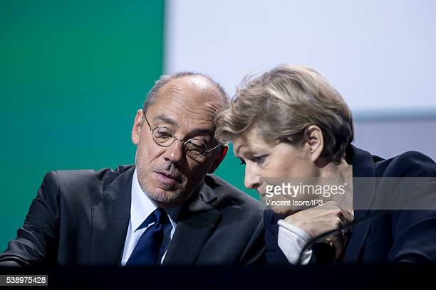 Orange CEO Stephane Richard speaks with Orange Executive Director Fabienne Dulac during the general shareholders meeting of French telecom operator...