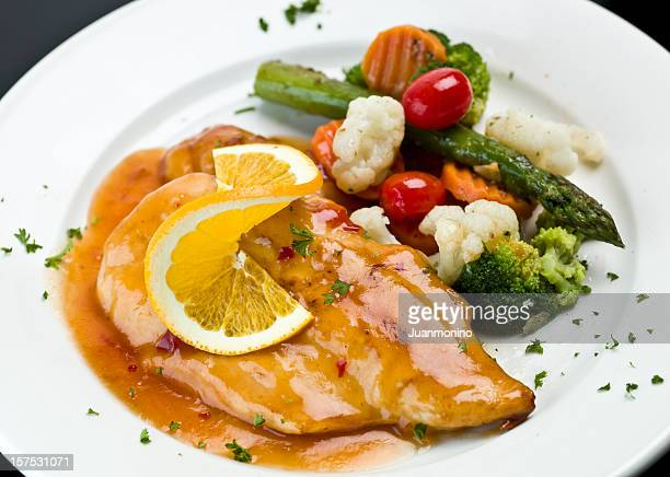 orange chicken breast - course meal stock pictures, royalty-free photos & images