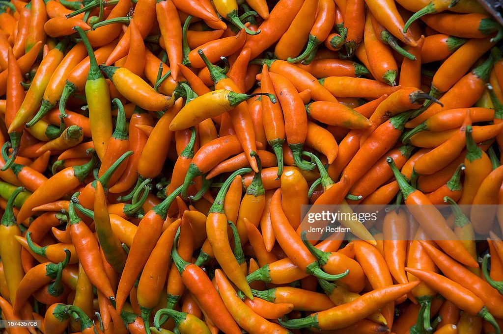 Orange chilies for sale at Pak Khlong Talat, a huge fresh-goods market in the center of Bangkok..