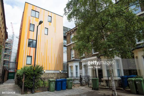 Orange cladding sits on a block of flats next to a row of terraced houses in Elephant and Castle on July 21 2017 in London England Over the last...