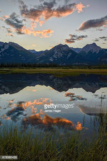 Orange clouds at sunset reflected in a lake, Jasper National Park, UNESCO World Heritage Site, Alberta, Rocky Mountains, Canada, North America