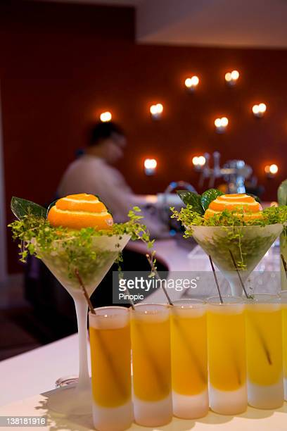 orange cocktails on a bar