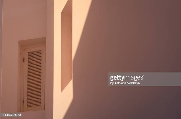 orange color minimalistic architecture abstract background, asilah, morocco - geometriestunde stock-fotos und bilder