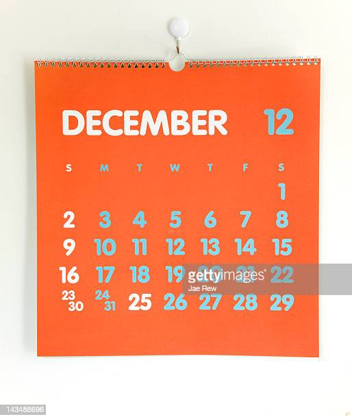 Orange colored calendar on white wall