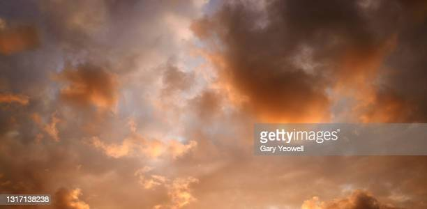 orange colored clouds at sunset - pink colour stock pictures, royalty-free photos & images