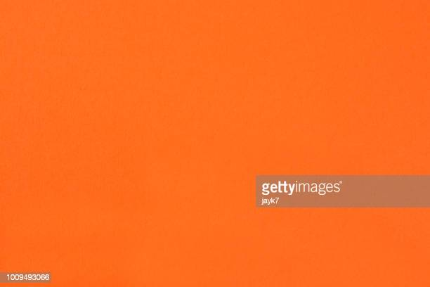orange colored paper background - orange background stock pictures, royalty-free photos & images